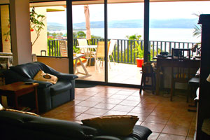 The open plan living room and kitchen as well as the deck have a great view of the cove, lake, and mountains.