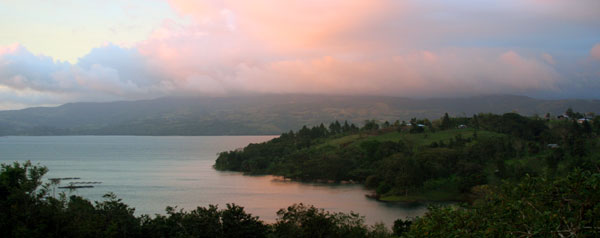 Sunset view of San Luis Cove and Lake Arenal from the condo.