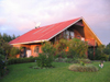 Extraordinary straw-bale volcano-view home on 3 3/4organic acres.