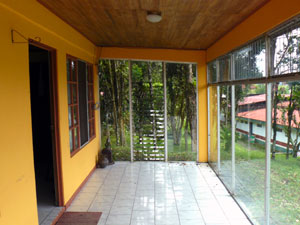 The Service Station Lago Arenal Is Seen From The Glassed Patio.