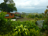 The home and cabina have a beautiful garden setting on an acre with volcano and lake views.