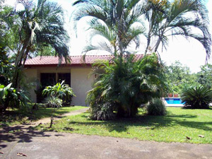 The very nice small home with with swimming pool has beautiful landscaping.